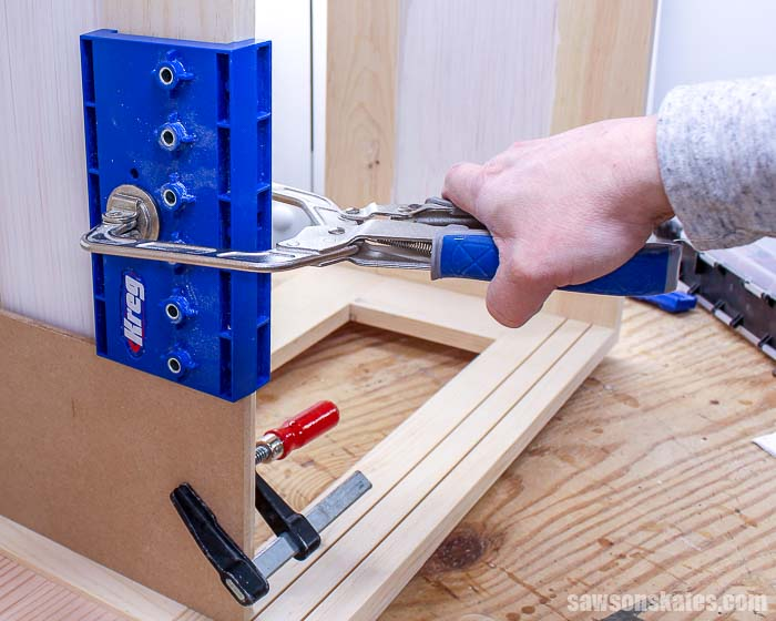 Kreg Shelf Pin Jig clamped to a cabinet