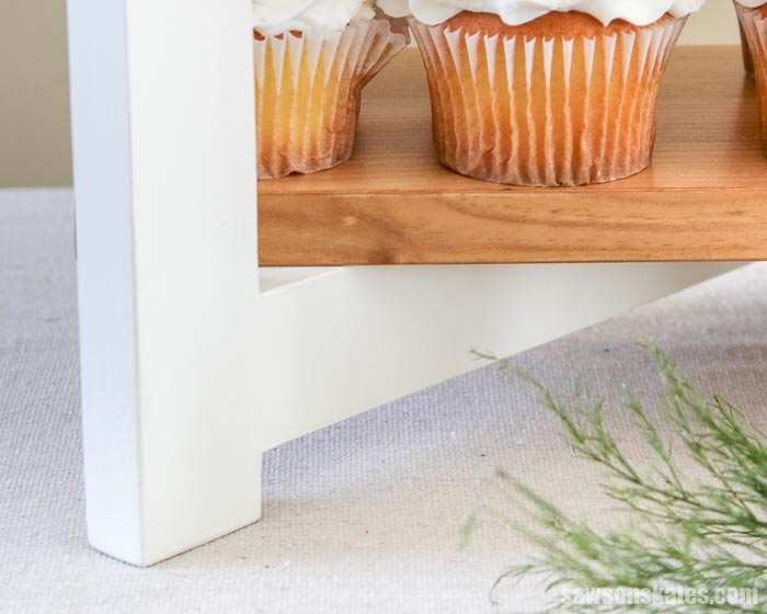 DIY cupcake stand with painted legs and stained wood shelves