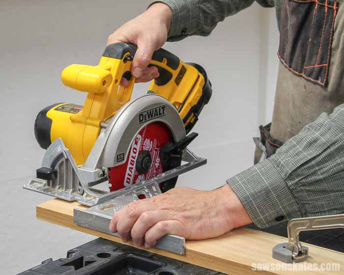 Using a circular saw and speed square to cut wood