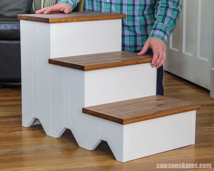 Give your pup a boost on the couch or bed with these DIY dog stairs! The wood stairs are easy to make, and the subtle farmhouse look complements any decor.