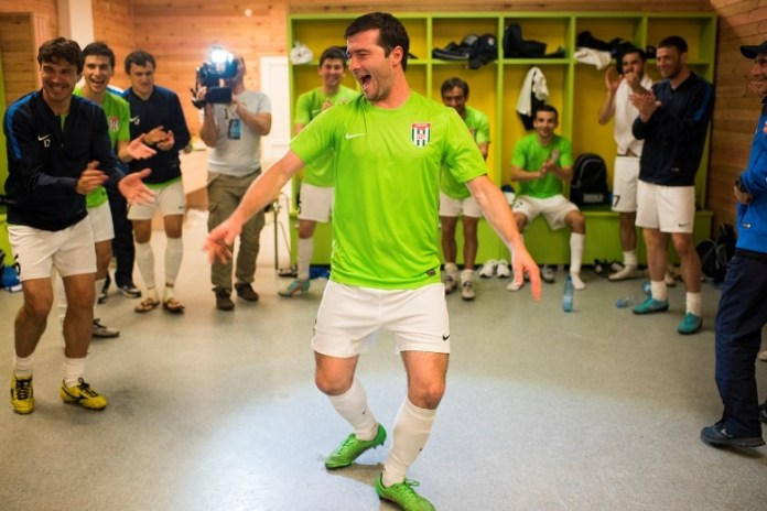 Abkhazia's George Djanaa performs a celebratory dance in the locker room after his team's 1-0 defeat of Western Armenia on May 31, 2016 in Sukhumi, Abkhazia. (Pete Kiehart for ESPN)