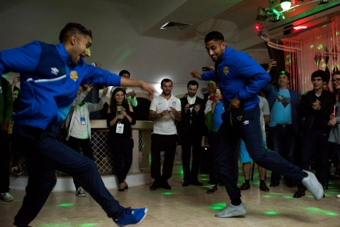 Panjab's Terlochan Singh, left, and Jaskaran Singh Basi, right, dance at a celebratory banquet following the closing ceremonies on June 6, 2016 in Sukhumi, Abkhazia. (Pete Kiehart for ESPN)