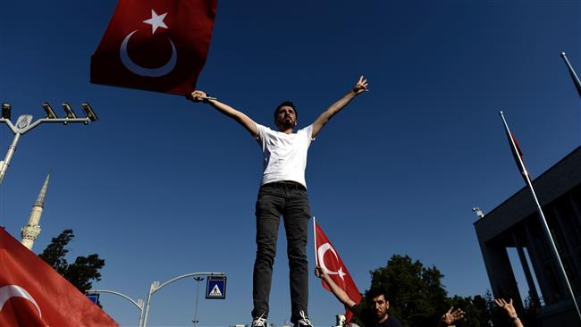 A man waves a Turkish flag during a demonstration in Istanbul in support of the government on July 16, 2016, following a failed coup attempt. (AFP)