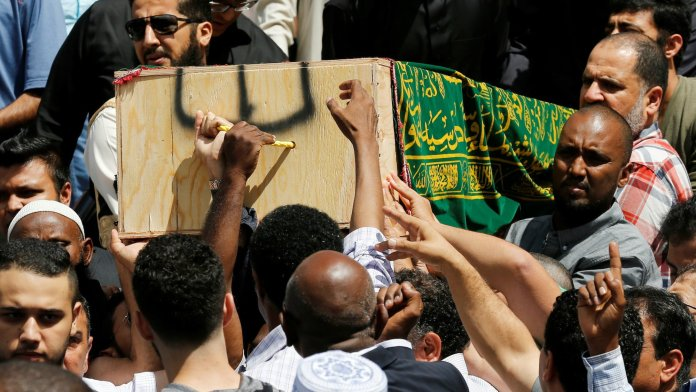 Mourners carry the casket of Abdirahman Abdi during his funeral on July 29.(Reuters/Chris Wattie)