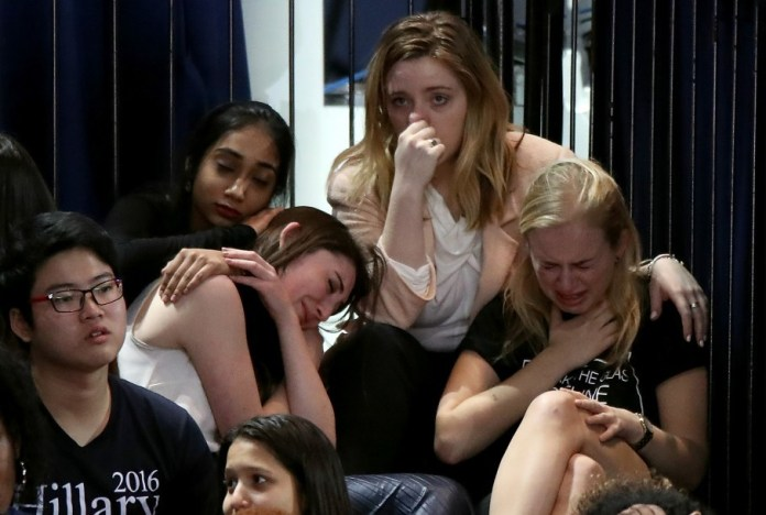A group of women react as voting results come in at Clinton's election night event at the Javits Convention Center in New York. (Drew Angerer/Getty Images)