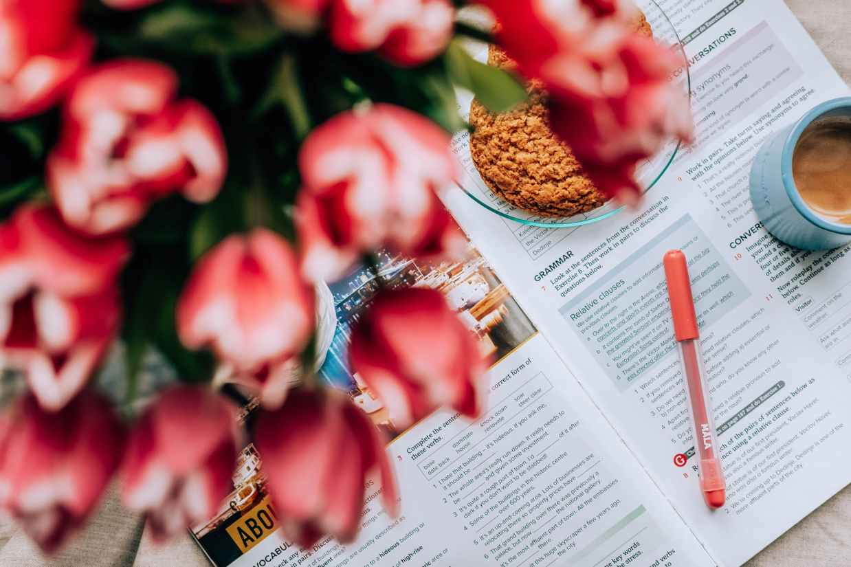 flowers and breakfast food on textbook