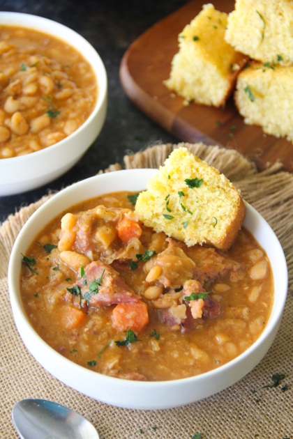 Creamy and tender white beans with chunks of smoky ham is chock full of flavor and makes for a comforting yet economical lunch or dinner