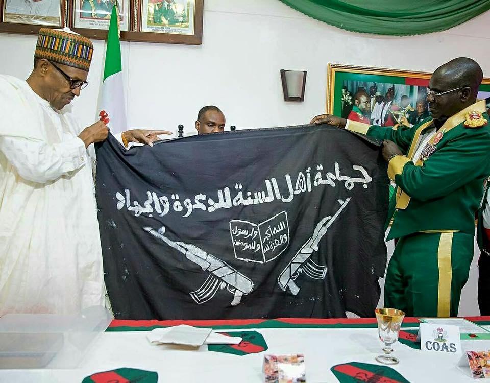 President Buhari Receives Boko Haram Flag