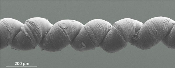 Carbon nanofiber. This coiled yarn is two times the width of a human hair. (Credit: Image courtesy of University of Texas at Dallas)