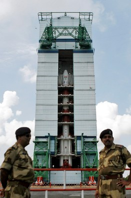 Soldiers stood guard in Sriharikota last week next to the launch vehicle (Source: Associated Press)