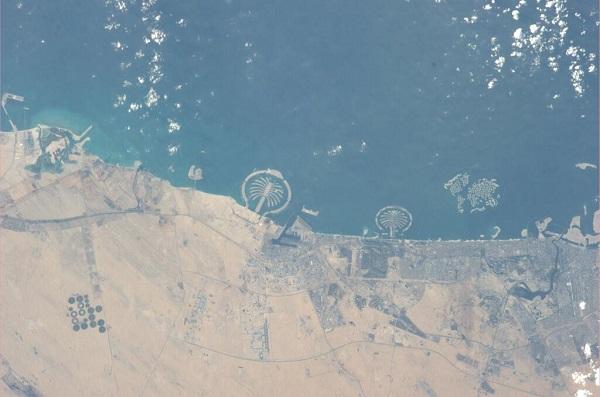 Man-made palm-shaped islands of Dubai, UAE (Credit: @ASTRO_WAKATA)