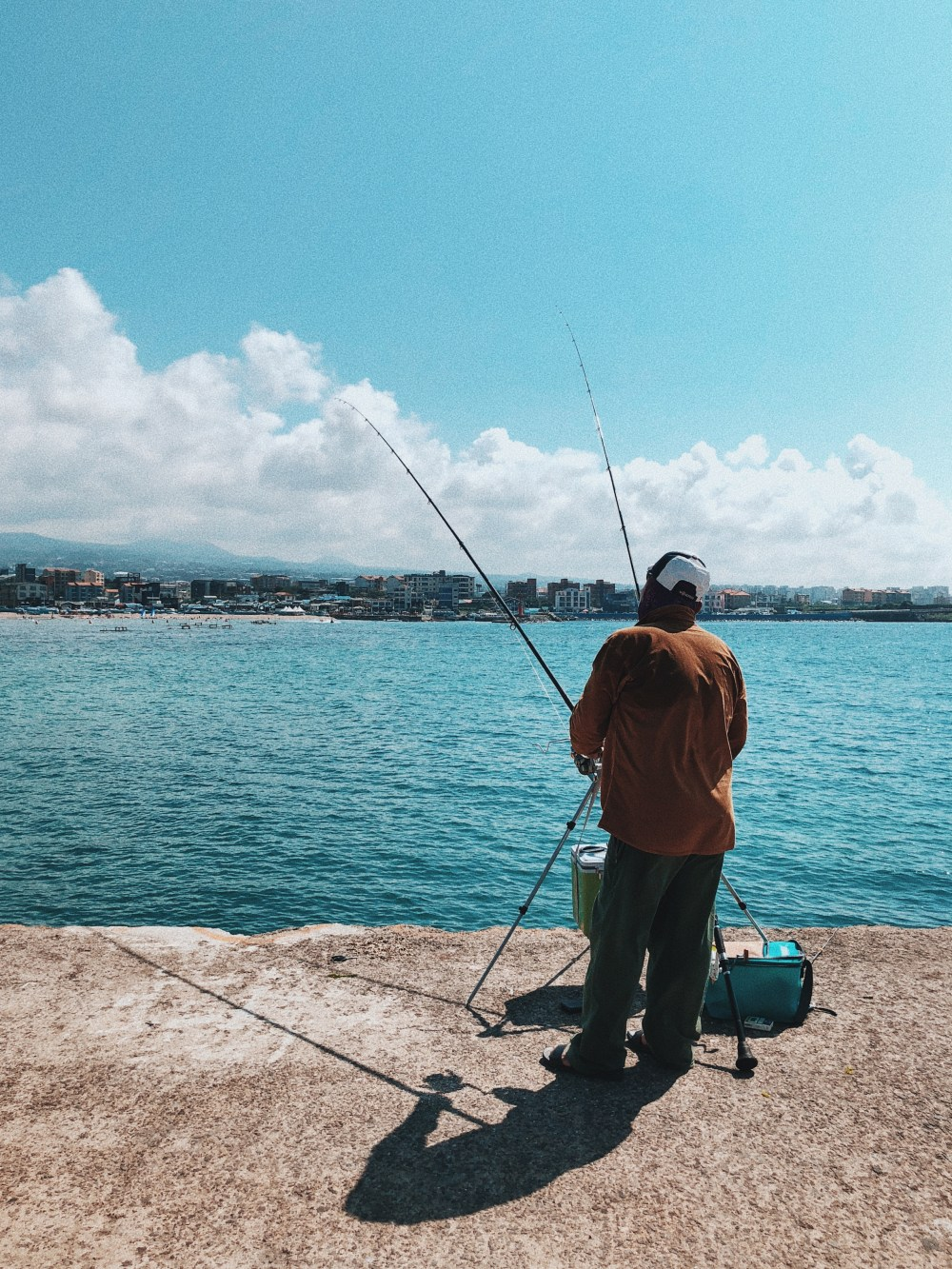 Man fishing alone during summer at Iho Tewoo Beach Jeju