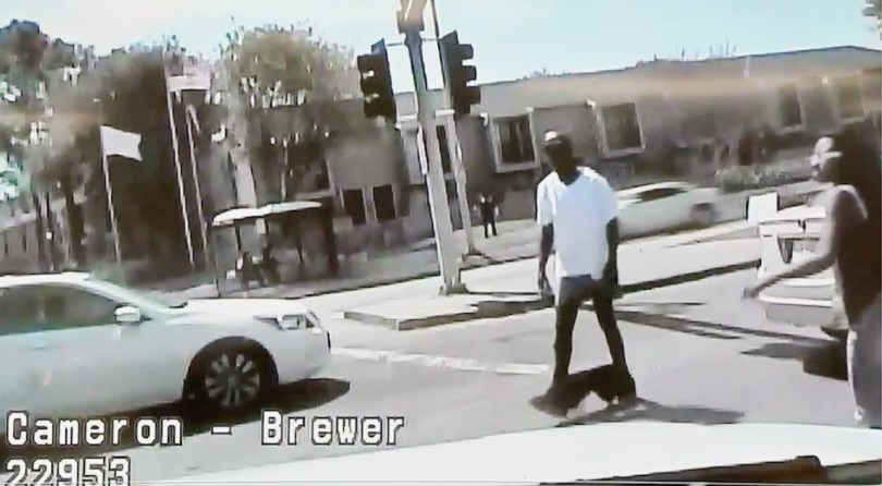 Unarmed black with pants around ankles