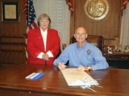 """Marion Hammer and Rick Scott pose at the bill signing of """"Docs vs. Glocks."""" (Florida Governor's Office)"""
