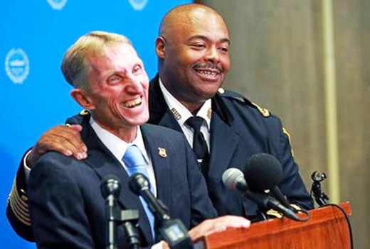 In this July 23, 2018 photo, newly appointed Boston Police Commissioner William Gross, right, speaks after he was introduced to succeed William Evans, left, at City Hall in Boston. Gross will be sworn in as the city's first African American police commissioner on Monday, Aug. 6. (Matt Stone/The Boston Herald via AP) Matt Stone AP