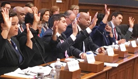 After hours of testimony before the House Finance Committee's Subcommittee on Housing, Community Development and Insurance, witnesses raise their hands in response to a question on whether homeownership discrimination against Blacks continues today. Seated left to right are: Alanna McCargo, vice president for Housing Finance Policy, Urban Institute; Nikitra Bailey, executive vice president, Center for Responsible Lending; Joseph Nery, president, National Association of Hispanic Real Estate Professionals; Jeff Hicks, president/CEO; National Association of Black Real Estate Brokers (NAREB); Carmen Castro, managing housing counselor, Housing Initiative Partnership; Joanne Poole, liaison for the National Association of Realtors; and Joel Griffith, research fellow, Financial Regulations, The Heritage Foundation. PHOTO: Hazel Trice Edney
