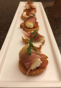 Delicious crostini topped with Spiced Pickled Quinces, home-cured prosciutto-style ham and chèvre.