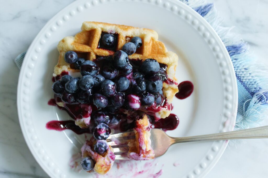 Belgian waffles with blueberry infused maple syrup