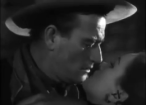 John Wayne and Ella Raines.