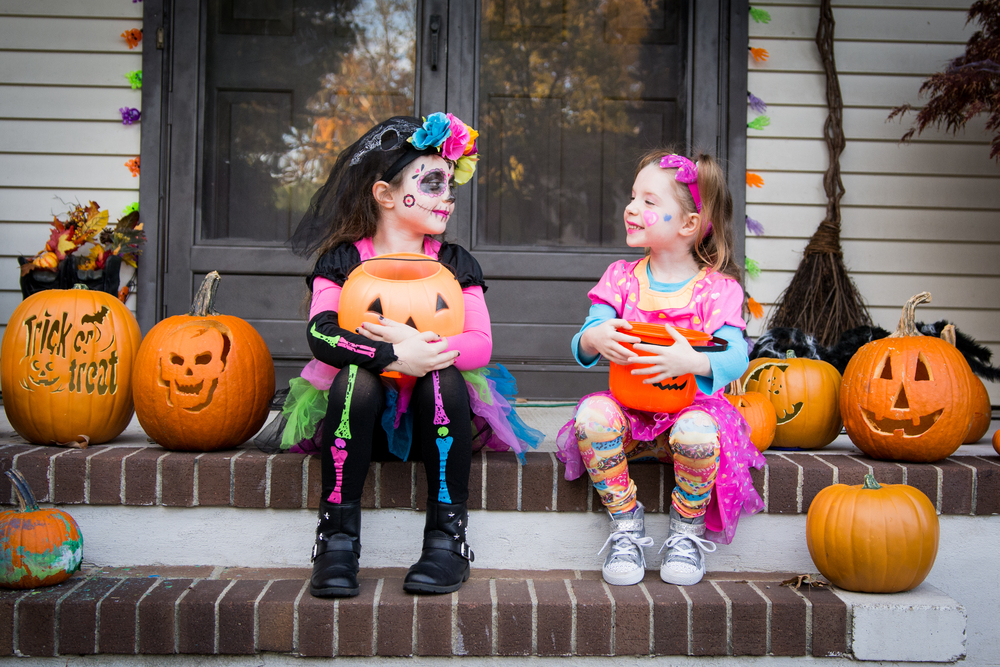 Children dressed up for Halloween on front porch