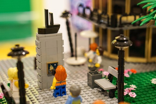 Minifigure photographing memorial in LEGO display in David Jones