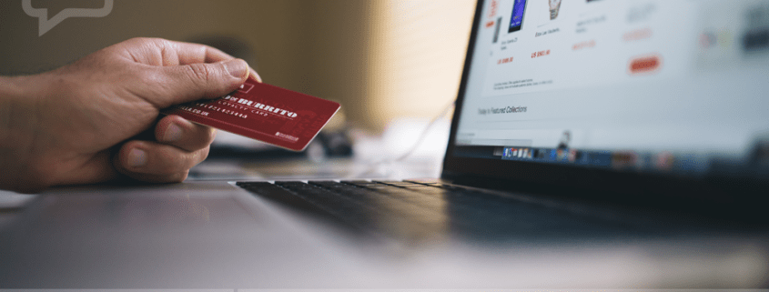 """A photograph of hand holding credit card, while browsing online merchandise, with the SB Marketing logo and the headline """"Make more online sales""""."""