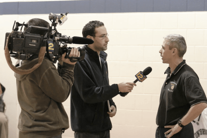 Coach Mike Hickey is interviewed by News 12 after the game