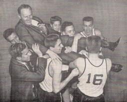 The boys hoist coach Jim Fenton after the victory
