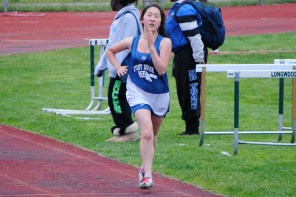 Rebecca Shin pushes through the pain in the 1500 walk