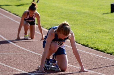 Rebecca Hollis crouches before the 400m hurdles
