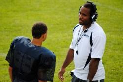Coach Ryan talks with Colucci