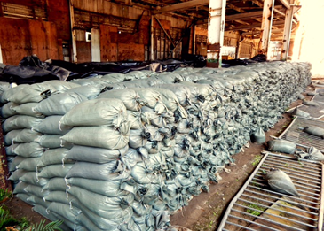 Nearly 50,000 sandbags stand ready for use.