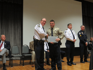 Dep. Christopher Manno Jr. receives his certificate from Maj. David DiMaggio.