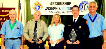 The Knights of Columbus in Chalmette honored the St. Bernard Sheriff's Deputy, Firefighter and Paramedic of the Year on Nov. 15. Shown from left are Dennis Bourgeois, Deputy Grand Knight; honorees Dep. Dustin Gould, Rhonda Serignet of Acadian Ambulance and Firefighter Capt. Martin Nehlig and Grand Knight Russell Serpas Sr.