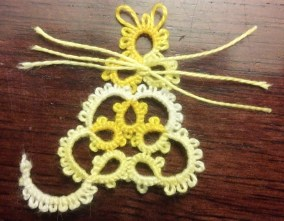 Pretty Tatted Kitty designed by Nancy Tracy. Tatted by Natalie Rogers. Perle Iris thread size 8 color 5020.
