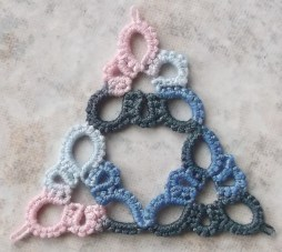 Tatted by Marie McCurry. This was done in Lizbeth, size 20, denim whispers. This motif reminds me of Anne B's dragon face. The triangles would make a wonderful doily. Check out her blog: http://westpinecreations.blogspot.com/