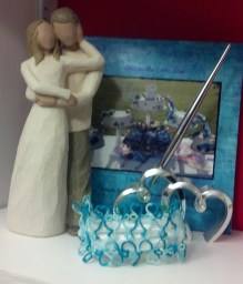 """I followed Gina's suggested variation of removing one of the 4-1-4-4-1-4 rows to fit the elastic I had purchased. I used Lizbeth thread size 20 color 158 (Niagara Falls) thinking of """"...something blue."""" The photo album in the background features my wedding cake which my sister-in-law made."""