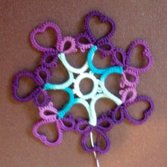 Challenge Accepted - Reader Submission for Weekly Challenge #7 - Variation of Gina Bea's Wedding Garter Pattern. Variation created and tatted by Natalie Rogers (I'm allowed to accept my own challenge, right?). Tatted in Lizbeth size 20 and colors Niagara Falls and Elderberry Jam. This is mock 1 of the variation. I'm currently working on a draft 2 that fixes some things.
