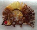Hedgehog designed by Nancy Tracy. Tatted by Natalie Rogers with bead selection by her youngest sister.