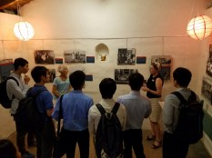 Kay Van Horn and Anne Petersen discuss the Nihonmachi Revisited exhibit with Japanese students from Education First. Photo by Kevin McGarry.