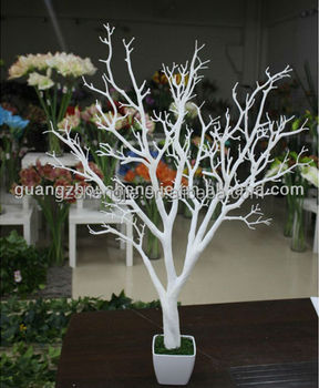 All White Tree Centerpiece With Tea Lights Surrounded By Flowers