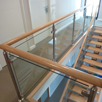 Side Mounted Glass Balustrade With Timber Handrail View Side | Glass Balustrade With Wooden Handrail | Contemporary | Glass Panel | Interior | Guardrail | Atrium
