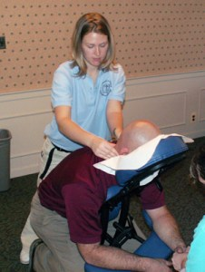 Therapeutic massage student practices on a patient.
