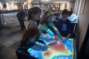 Children use the mapping sandbox in the SC4 Experience Center.