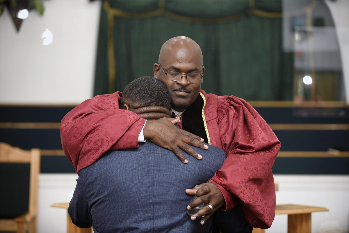 The Reverend Kenneth B. Thomas Sr., pastor of Bethesda Worship and Healing Center in Jonesboro, Arkansas, hugs Cory Brigham after ordaining him into the ministry during Sunday service on August 15, 2021. All photos by Terrance Armstard for The Guardian.