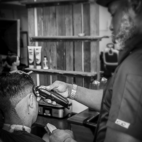 Interior photo of the barbershop during a haircut