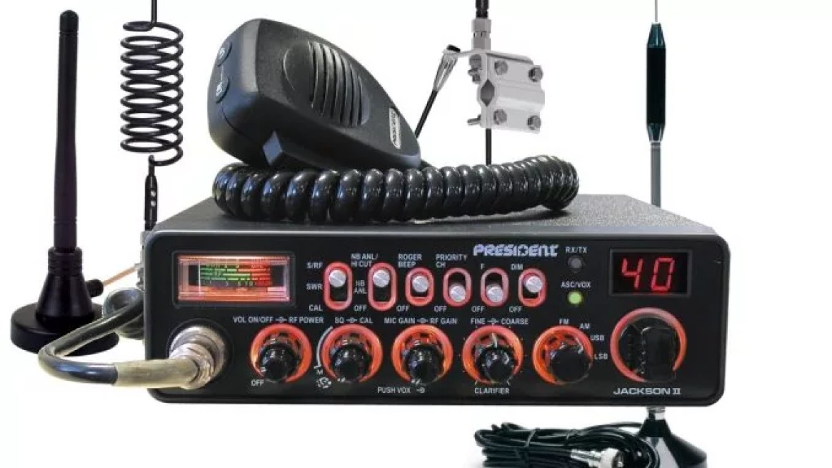 A colourful of technology. with a large aerial, desktop sized, with a speaker and microphone. It's a CD radio system