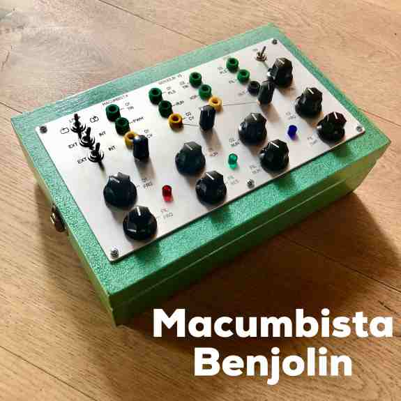 A strange green metal box sits on the floor. The top of the box features a series of neatly arranged black knobs and switches. Underneath the image in bold white type it says MACUMBISTA BENJOLIN
