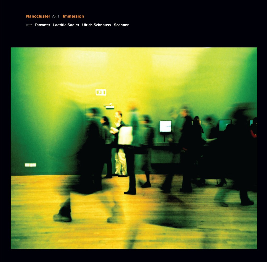 """An album cover, with a distorted blurred image of people walking in a museum with a bright yellow tone to the image. Text at the top reads """"Nanocluster Vol1 Immersion"""""""