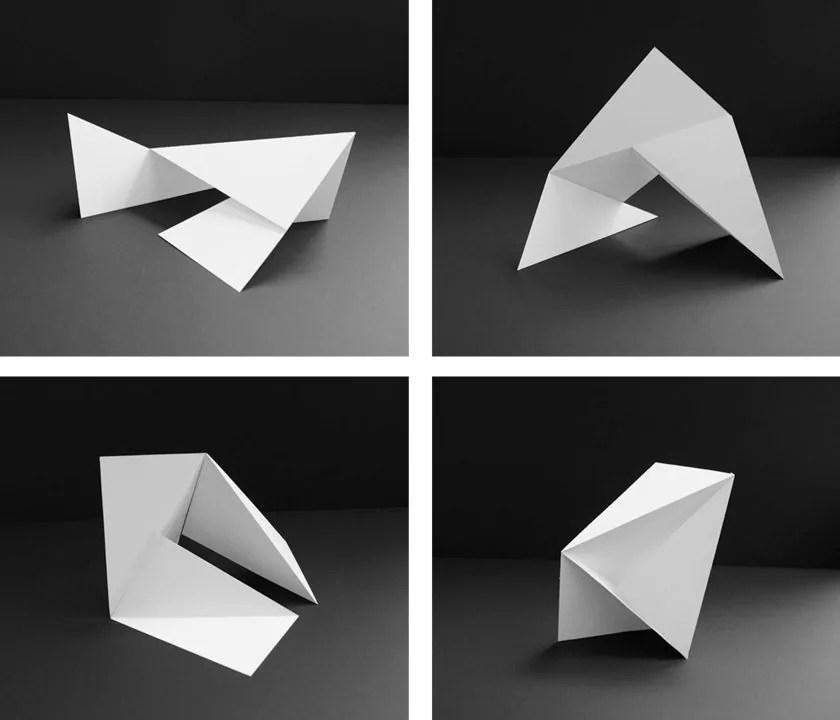 Black and white image divided into four sections, each featuring an image of a piece of paper folded into different architectural shapes